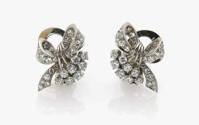 A pair of bow-shaped stud earrings with brilliant cut