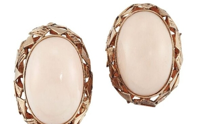 A pair of coral earclips, each oval...