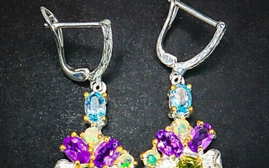 A pair of ear pendants each set with numerous oval and circular-cut amethysts, peridots and topazes, mounted in rhodium and gold plated sterling silver. (2)