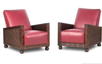 A pair of early 20th century 'alhambra smoking room' style carved oak and leather arm chairs