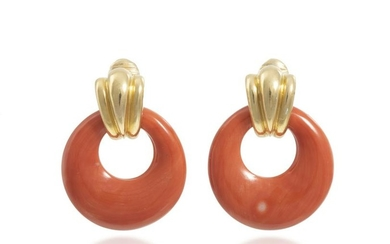 A pair of gold ear clips with interchangeable hoops