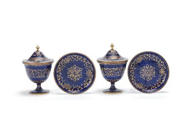 A pair of rare gilt-decorated blue enamel covered stem cups and stands