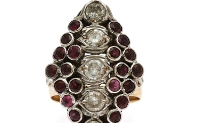 A ruby and diamond ring set with numerous circular-cut rubies and five brilliant-cut diamonds, mounted in 14k gold and white gold. Size 57.