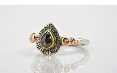 A silver, rose gold and salt and pepper diamond ring, featur...