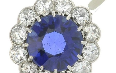 A synthetic sapphire and diamond cluster ring.Estimated