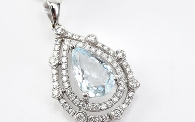 AN AQUAMARINE AND DIAMOND PENDANT - Featuring a pear brilliant cut aquamarine weighing 1.83ct, surrounded by a double border set wit...
