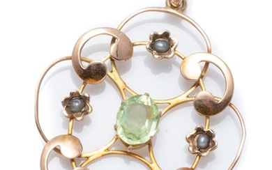 AN EDWARDIAN 9CT ROSE GOLD STONE SET PENDANT; open scrolling frame centring an oval cut green paste to surround of 4 seed pearl set...