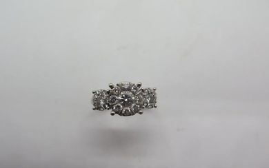 An 18ct white gold hallmarked diamond triple cluster ring, t...