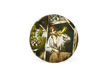 An enamelled stained glass roundel of a horn player