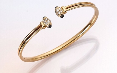 CARTIER 18 kt gold bangle with diamonds...