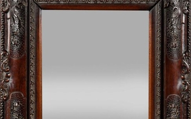 Carved exotic wood mirror decorated with foliage on a dotted background, palmettes and flowers. (a frame originally, glass brought back at a later date). Probably Portuguese Indies, 18th century. H : 47 cm, W : 42 cm