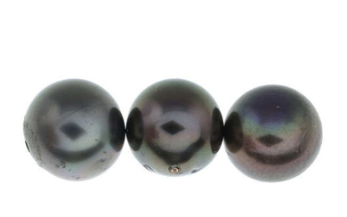 Eleven black cultured pearls, total weight 9.0gms.