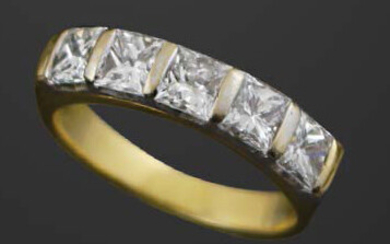 FACE in yellow and white gold with princess-cut...