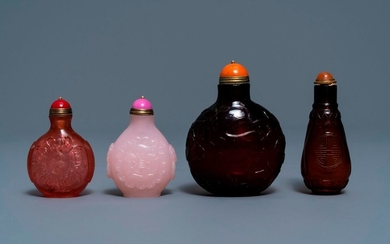 Four Chinese cherry red and pink glass snuff...
