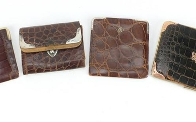 Four crocodile skin effect leather wallets and purses,