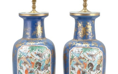 PAIR OF CHINESE POLYCHROME PORCELAIN VASES In rouleau form, with two famille verte cartouches depicting warriors on horseback. Powde...