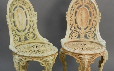Pair iron outdoor chairs with medallion backs and rams