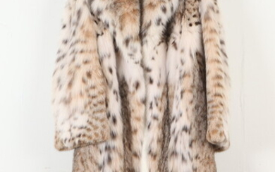 ROSENDORF EVANS LYNX FUR COAT WITH IVORY-COLORED SATIN LINING. -...