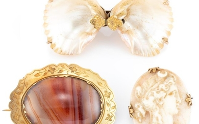 THREE ANTIQUE GOLD FRAMED STONE BROOCHES; 18ct gold engraved brooch set with a banded agate, (4 x 3cm), wt. 9.73g, a shell cameo por...