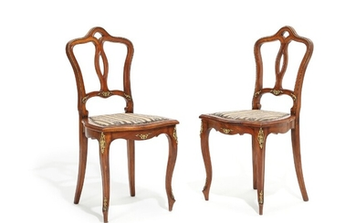 Two Austrian walnut Rococo style chairs, adorned with bronze mountings. Circa 1900. (2)