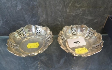 Two small pierced silver dishes, each on three feet, Walker ...