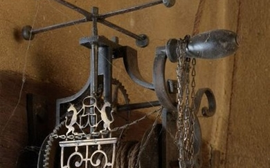 Wrought iron turn-spit decorated with a cut-out brass...