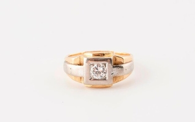 Yellow and white gold (750) Tank type ring set with an old fashioned brilliant cut diamond, about 0.20 carat, in grit setting on a square bezel.