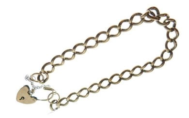 Yellow metal curb-link bracelet with heart-shaped padlock, indistinctly stamped,...