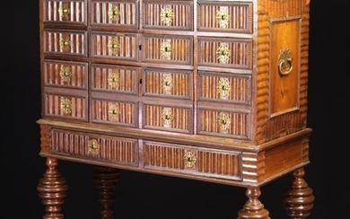 A 17th Century Portuguese Collector's Cabinet on Stand. The rosewood veneered chest housing drawers