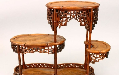 A 19TH CENTURY CHINESE CARVED HARDWOOD THREE TIER