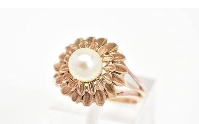 A CULTURED PEARL RING, of a tiered floral design set with a ...