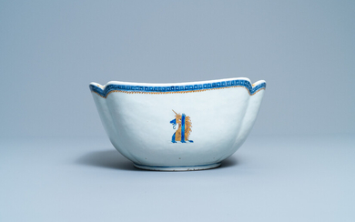 A Chinese blue, white and gilt English market bowl with the arms of Gale, Qianlong