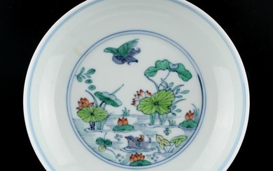 A Chinese doucai saucer dish painted with a pond...