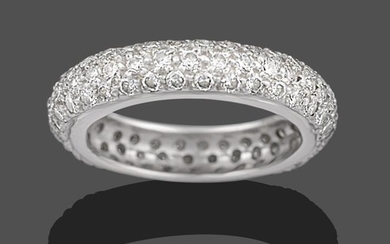 A Diamond Bombé Eternity Ring, three rows of round brilliant...