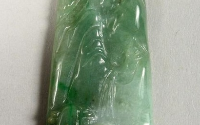 A GOOD CHINESE CARVED JADE PENDANT, carved one side to