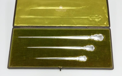 A GRADUATED SET OF THREE STERLING SILVER MEAT SKEWERS