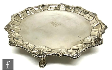 A George III hallmarked silver card waiter with engraved cen...