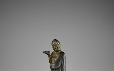 A LACQUER-GILT BRONZE FIGURE OF A LUOHAN, MING