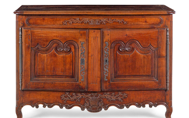 A Louis XV Provincial Carved Walnut Cabinet