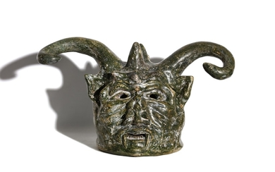 A MYSTERIOUS AND LARGE 19TH CENTURY PAINTED TERRACOTTA HEAD OF A DEVIL, DATED 1873