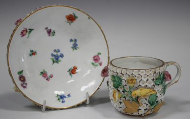 A Meissen porcelain schneeballen cup and saucer, late 19th century, the cup exterior and saucer unde