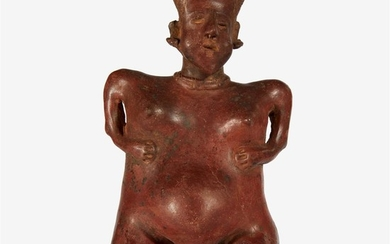 A Nayarit pottery figure of a pregnant woman 100...