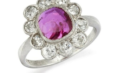 A PLATINUM RUBY AND DIAMOND CLUSTER RING, the cushion