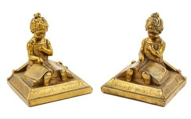 A Pair Of Gilt Metal Bookends Height 6 1/2 Inches.