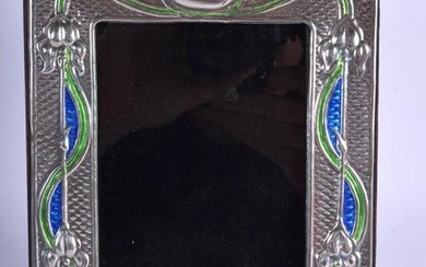 A SILVER AND ENAMEL PHOTOGRAPH FRAME. 15 cm x 19 cm.