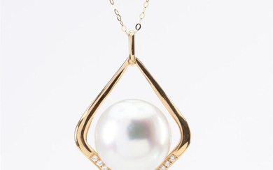 A SOUTH SEA PEARL AND DIAMOND PENDANT - Featuring a round pearl of silver white hues measuring 15.5mm, within a diamond shaped surro...