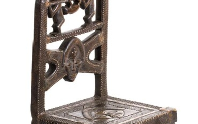 A WOODEN AND BRASS THRONE