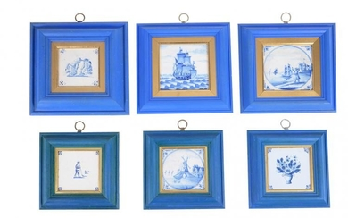 A collection of twenty-two blue and white Dutch Delft tiles