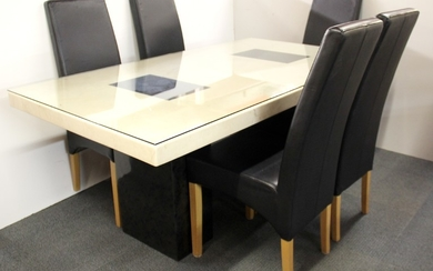A large glass topped marble dining table, size 180 x 100 cm with five leather upholstered dining chairs.
