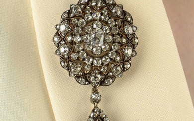 A late Victorian silver and gold rose-cut diamond floral cluster brooch/pendant, with similarly-set detachable drop.